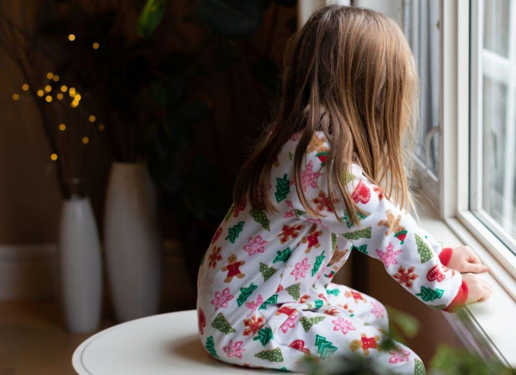child-sitting-by-window